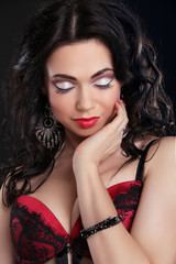 Beautiful and sexy girl wearing red lingerie over dark. Attracti