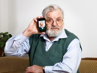 Senior showing mobile