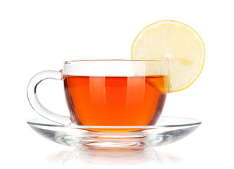 Glass cup of black tea with lemon slice