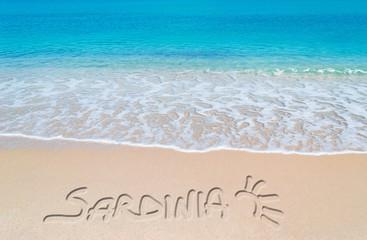 turquoise foreshore with sardinia writing