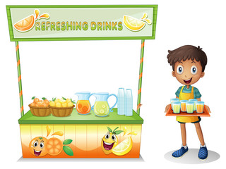 A boy with a stall of refreshing drinks