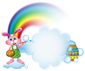 Deurstickers Regenboog A bunny painting near the rainbow