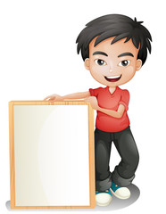 A boy holding an empty framed board