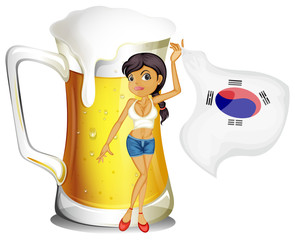 A girl with the Korean flag in front of a mug of beer