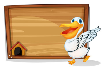 A duck dancing beside a wooden blank board