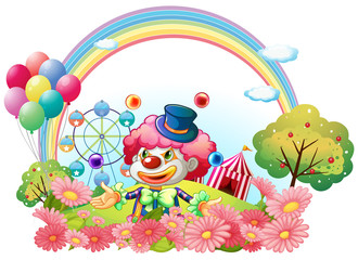 A clown in the garden with a carnival at the back