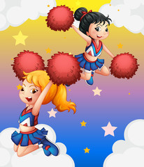 Cheerdancers with red pompoms