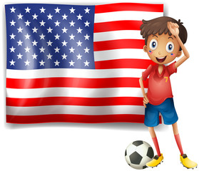 A boy with a soccer ball in front of the USA flag