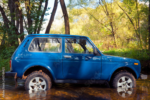 Soviet and Russian SUV Lada Niva 4x4 in water