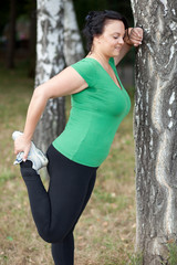 Woman stretching/warming up before running. Selective focus.