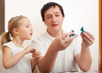 Girl and dad molded from clay toys