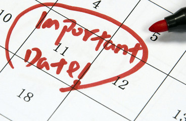 important date sign written with pen on paper