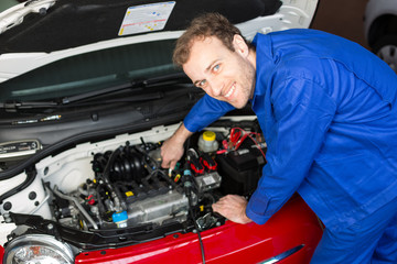 Mechanic repairing a car in a workshop or garage