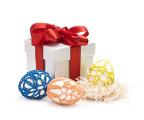 Easter eggs and gift in a box with a bow, isolated on the white