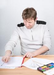 Young man having fun painting