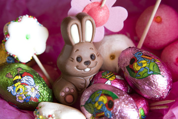 Easter bunny and eggs in a pink sweet background.
