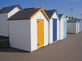 Row of beach huts on a sunny day