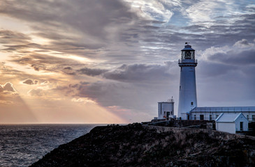 Foto op Canvas Vuurtoren South Stack Lighthouse sunset Isle of Anglesey North wales UK