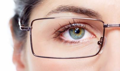 Eye with eyeglasses.