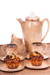 Coffee service and muffins on a plate on white isolated