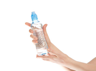 drinking water bottle in woman hands