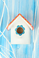 Decorative nesting box on color background