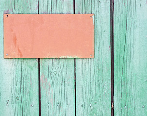 Wooden signboard hanging on planks background
