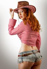 Woman wearing cowboy hat
