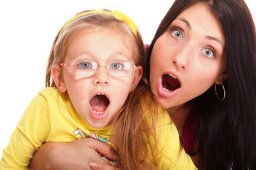 surprised little baby girl playing mom