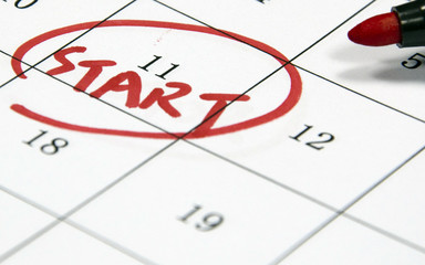 start sign written with pen on date