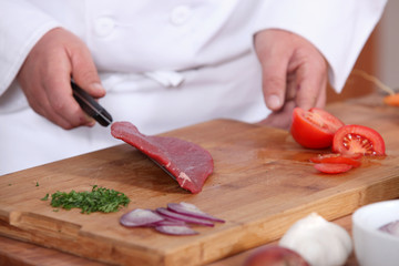 Male hands preparing steak
