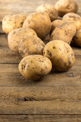 Organic potatoes on wooden table