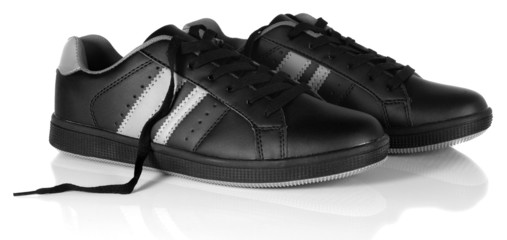 Black new sneakers with unfastened shoe laces