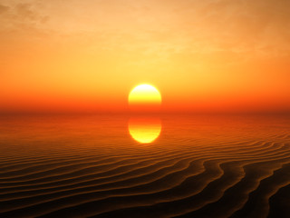 Sunset showing behind sand ripples