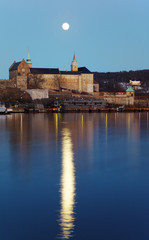 Full moon over Akershus castle. Reflection.