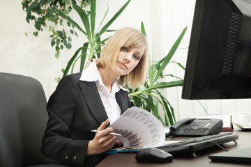 Woman working with computer in the office