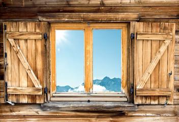weathered mountain hut window shutter