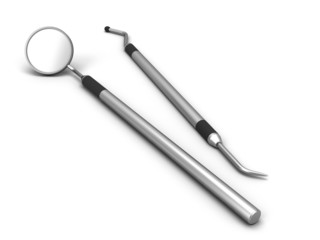 Dental mirror and dental pick on a white background.