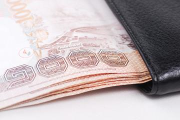 Bank in black wallet