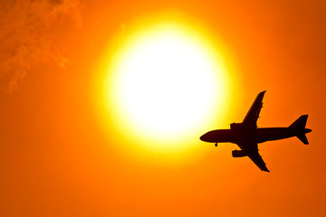 Aircraft on sunset background