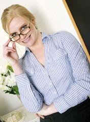Beautiful Blond Intellectual Woman in the Field Education