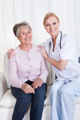 Portrait Of Doctor And Patient Sitting On Couch
