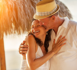 Happy senior couple in love at tropical beach