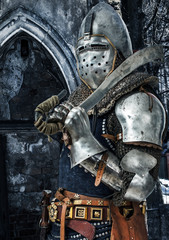 Foto op Canvas Ridders Armored knight with his sword