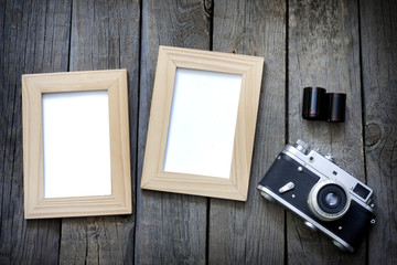 Old empty photos frame with retro camera background concept