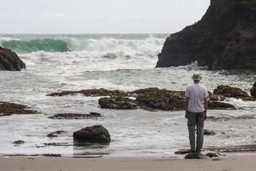 man admiring waves