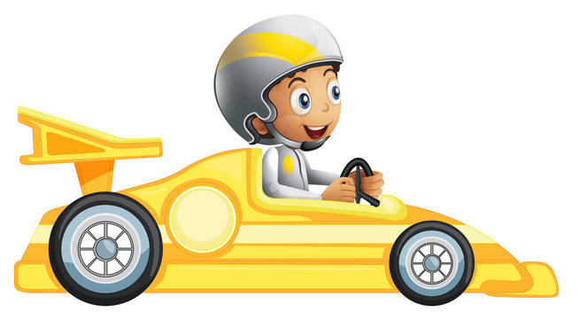 A boy riding in a yellow racing car