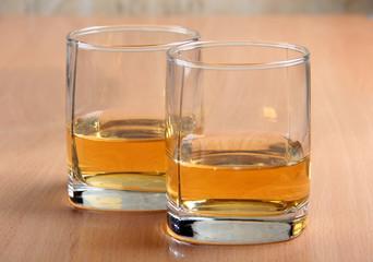 Whiskey glasses on wood