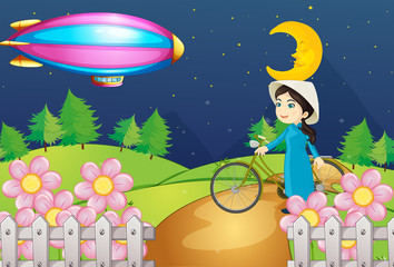 A woman with a bike and the stripe airship