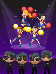 Four cheerdancers dancing with spotlights